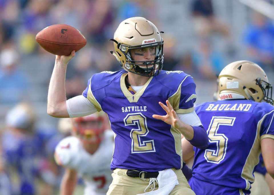Sayville's Jacob Cheshire looks to pass during the