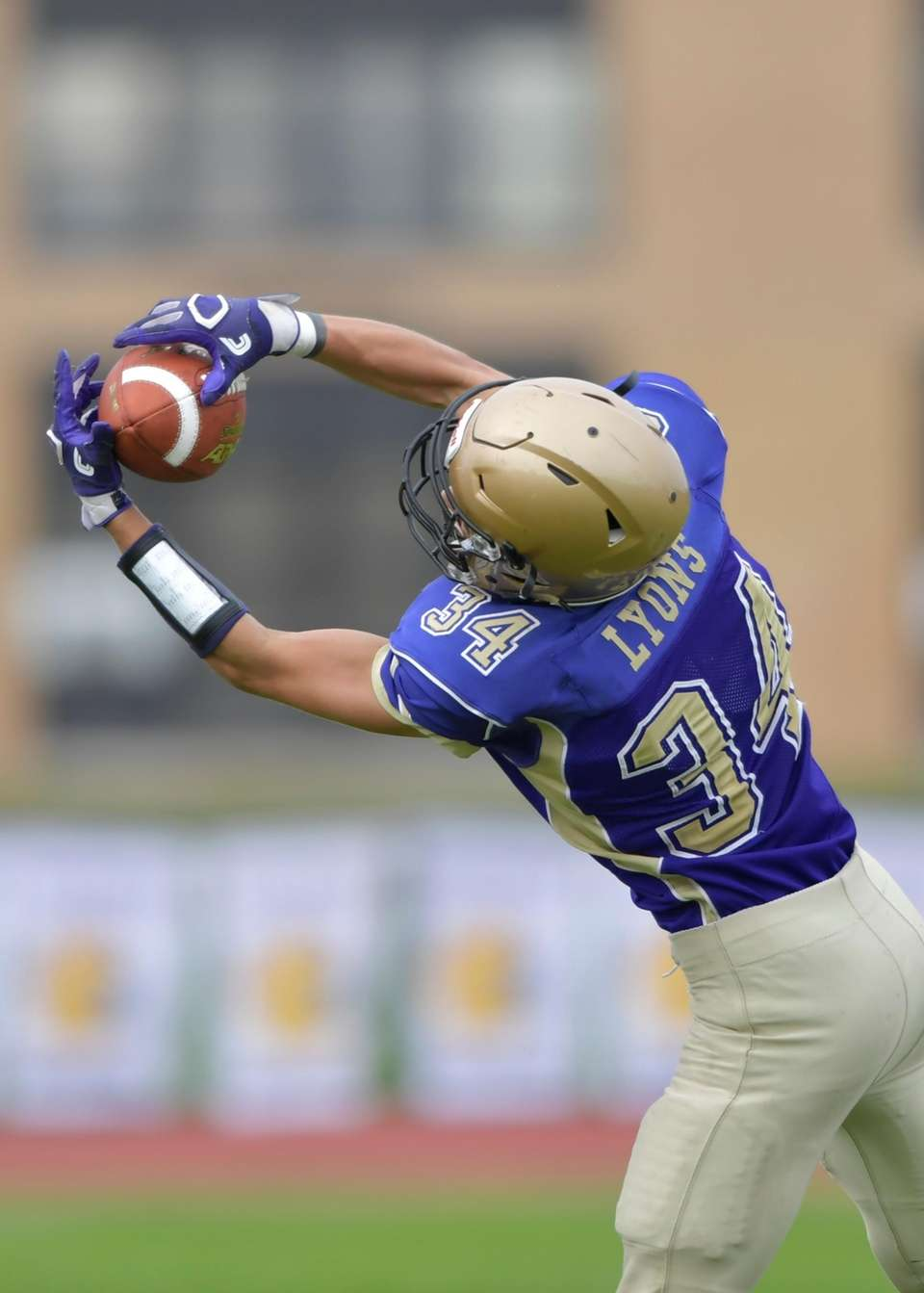 Sayville's James Lyons makes the catch during the