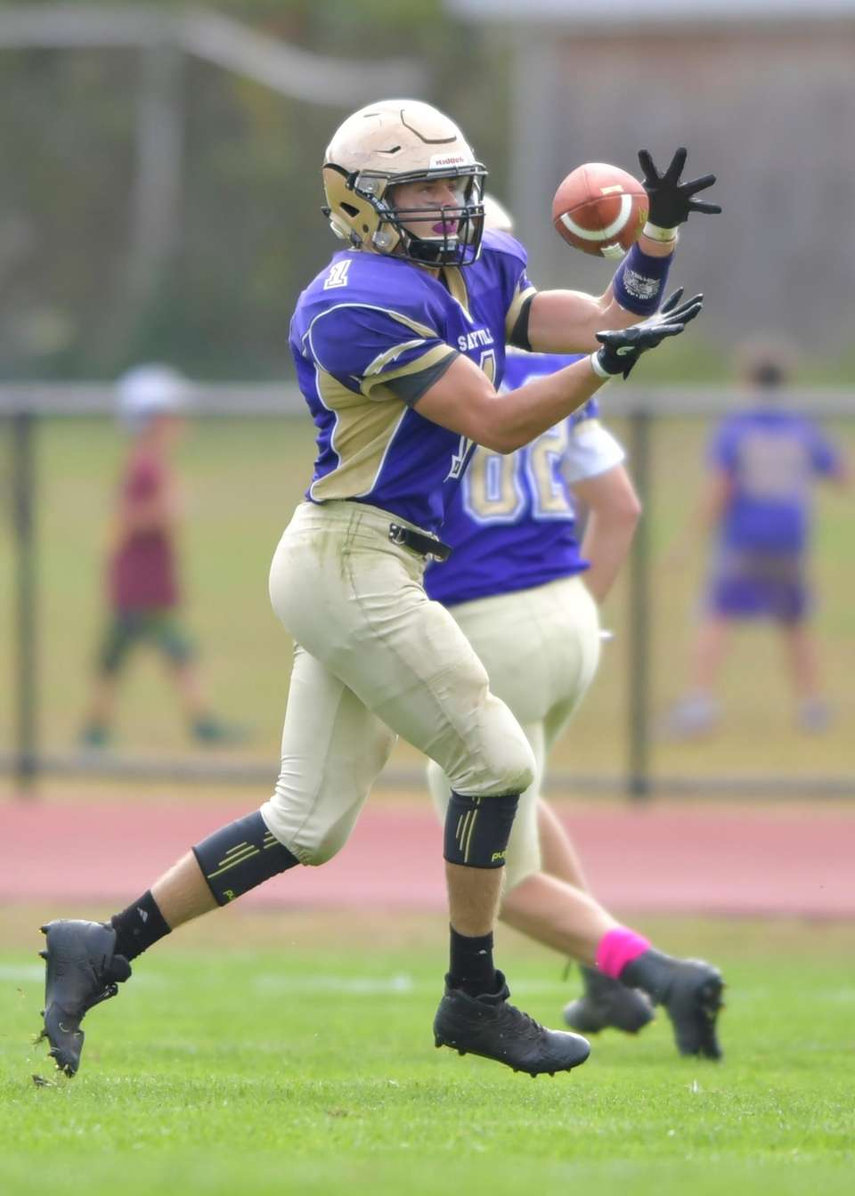 Sayville's Max Kolar makes the catch during a
