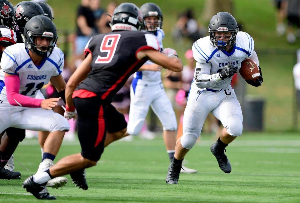 Alec Kiernan of Centereach runs the ball against