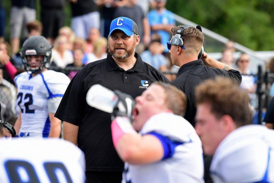 Head coach Adam Barrett of Centereach looks on