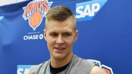 Kristaps Porzingis speaking to the media after practice