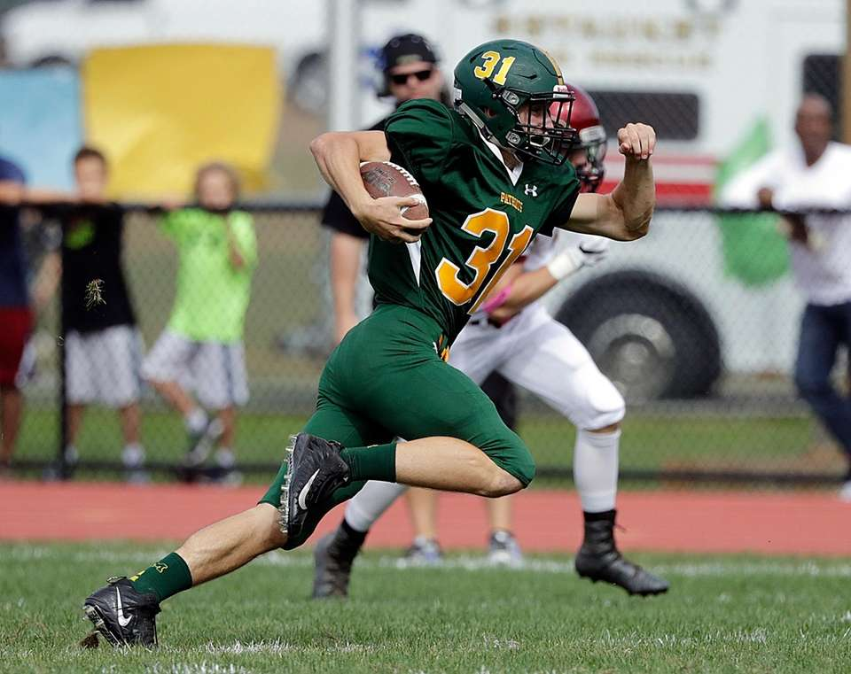 Ward Melville's Nick Messina (31) races to the