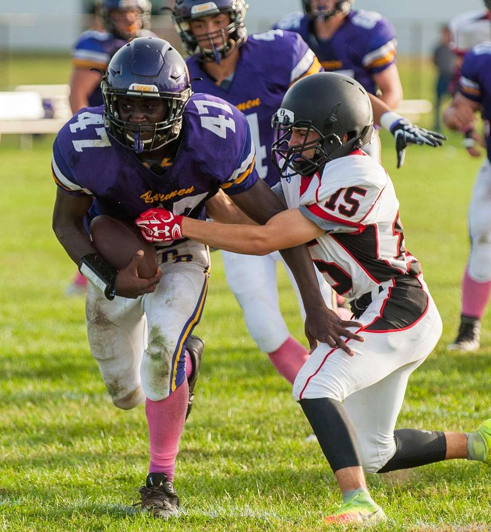 Oyster Bay's Yahve Jean-Baptiste tries to get past