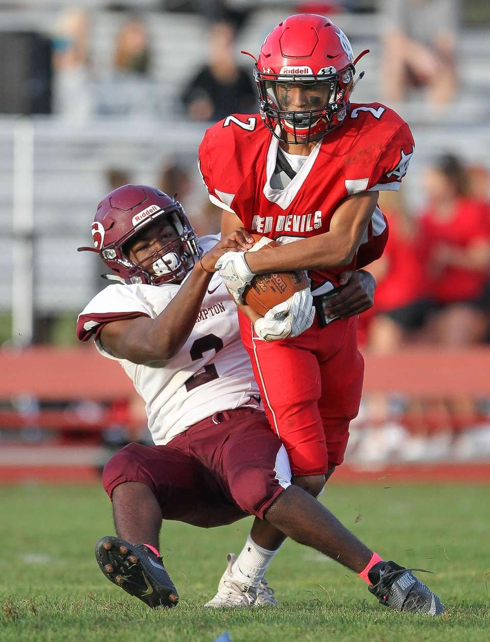 Southampton's Adonis Hutchings (2) takes down Center Moriches