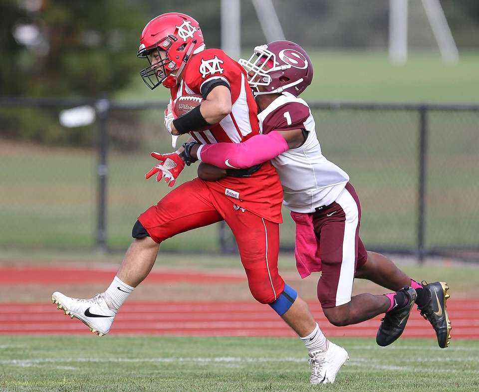 Center Moriches John Mercado (20) carries the ball