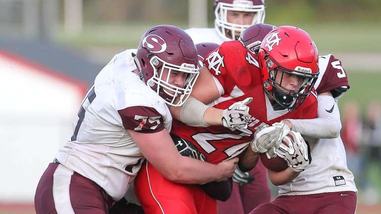 Center Moriches Nathan Sigerson (24) runs the ball