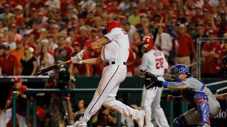 Washington Nationals' Ryan Zimmerman hits a three-run home