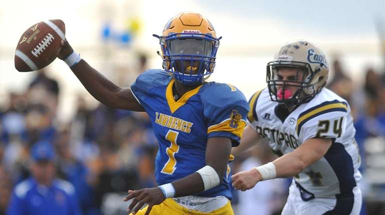 Christian Fredericks #1, Lawrence quarterback, left, scrambles to