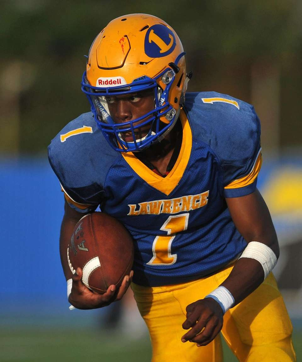 Christian Fredericks #1, Lawrence quarterback, runs for a