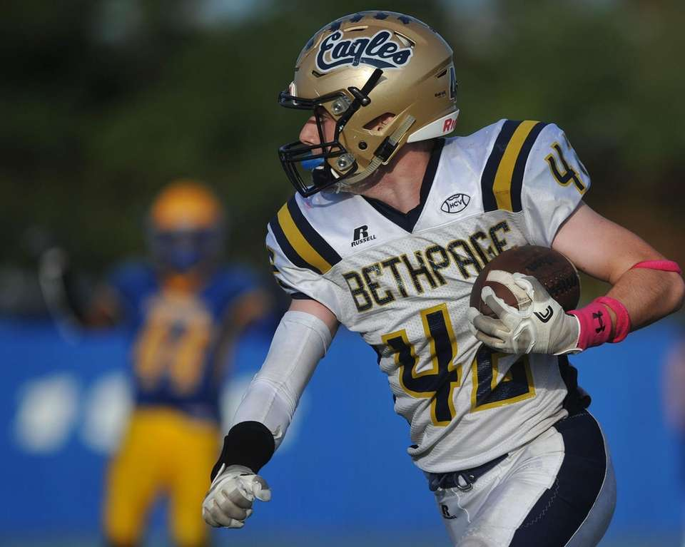Matt Groom #42 of Bethpage picks up yards