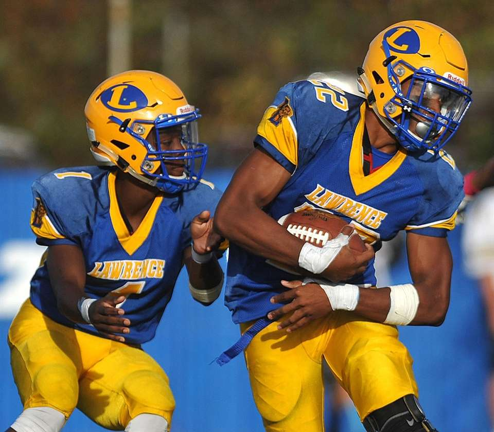 Chris Collier #22, Lawrence running back, right, takes