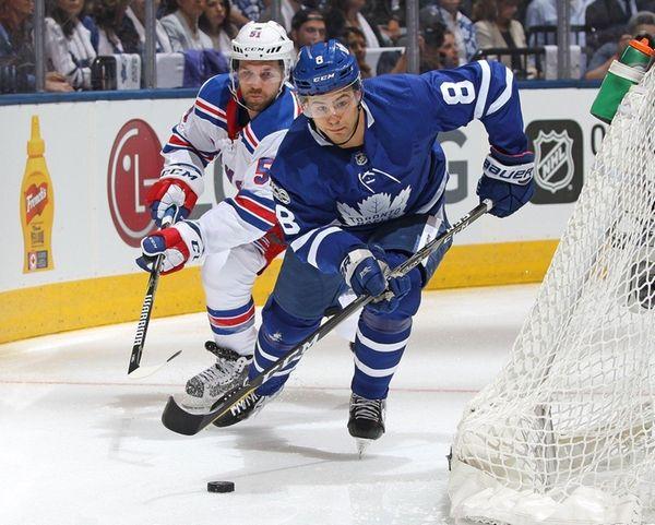 Maple Leafs beat Rangers 8-5 in wild home opener