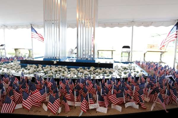 Flags, some with messages, are placed in the