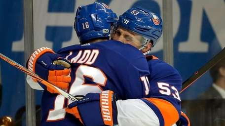 Islanders left wing Andrew Ladd celebrates with center