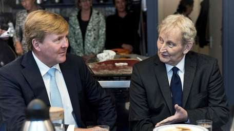 Dutch King Willem-Alexander, left, visits with Amsterdam Mayor