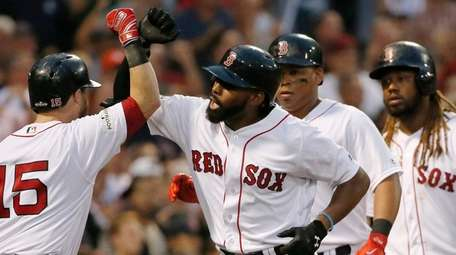 Jackie Bradley Jr., center, is greeted at home