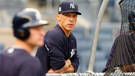 Manager Joe Girardi of the Yankees looks on