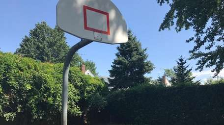 Village officials in August had removed the hoops
