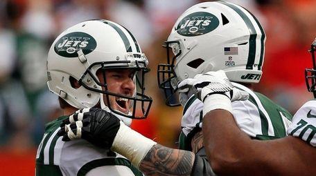 Jets kicker Chandler Catanzaro, left, is congratulated by