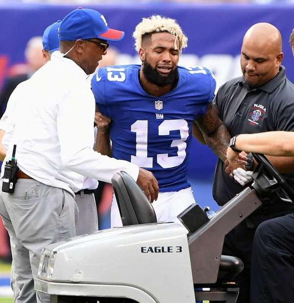 Giants receiver Odell Beckham Jr. is assisted onto