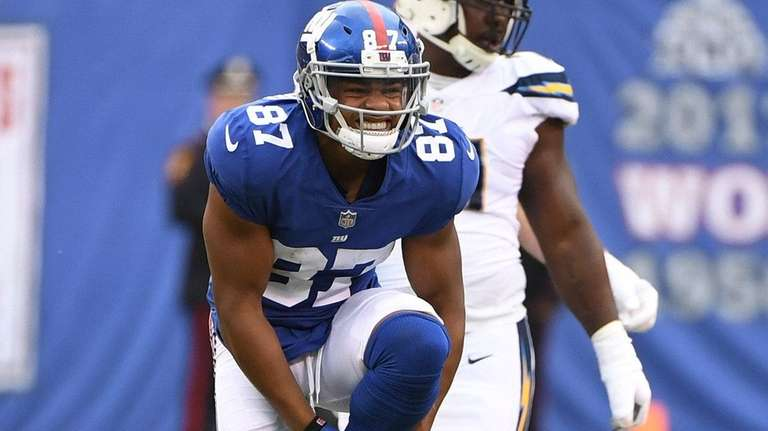 Giants wide receiver Sterling Shepard holds his left