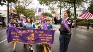 Revelers braved the rain Sunday, Oct. 8, 2017,
