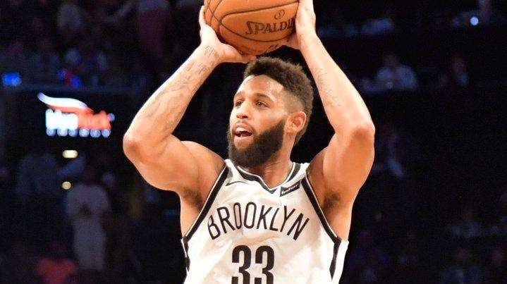 Nets guard Allen Crabbeshoots a three-pointer against the