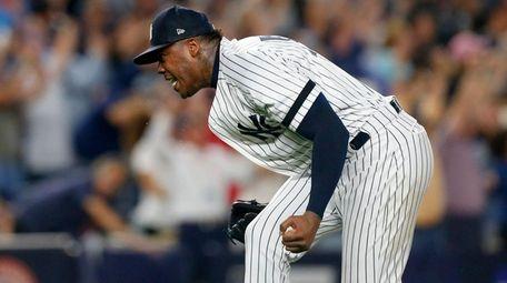 Aroldis Chapmanof the Yankees reacts after the final