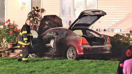 Firefighters on the scene where a car crashed