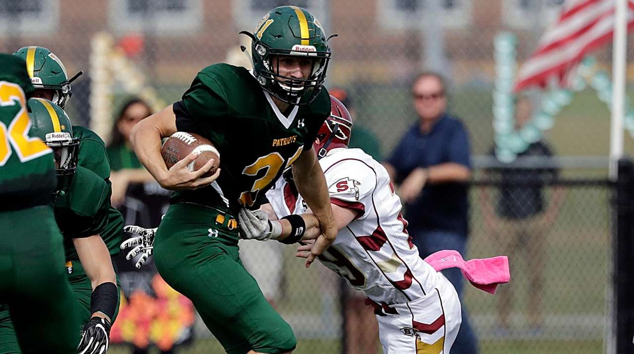 Ward Melville's Nick Messina (31) breaks the tackle
