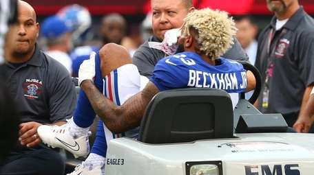 Giants receiver Odell Beckham Jr. is tended to