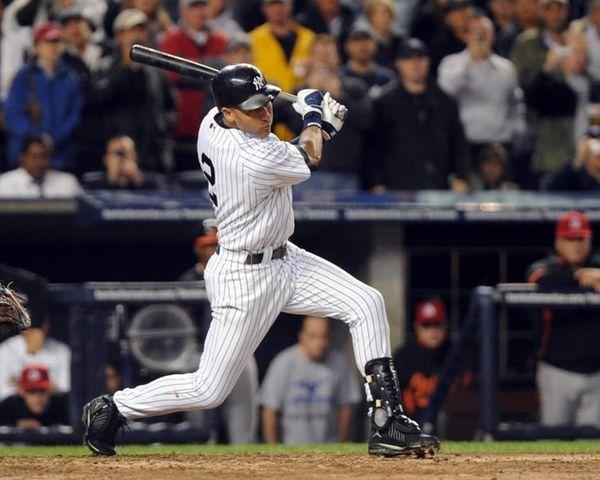 The Yankees' Derek Jeter singles in the third