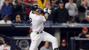 The Yankees' Derek Jeter singles in the third