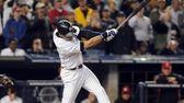 New York Yankees' Derek Jeter (2) singles in