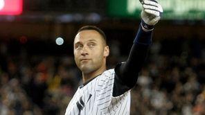 The Yankees' Derek Jeter waves to the crowd