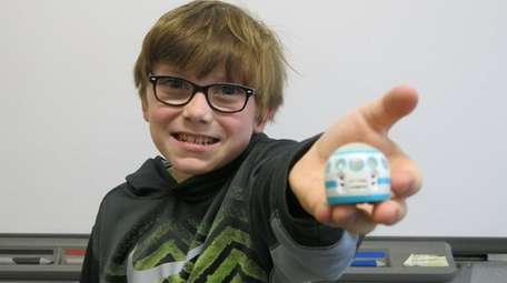 Kidsday reporter Jack Dunn with the Ozobot Evo.