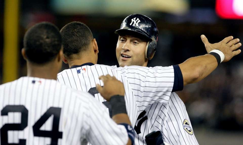 Derek Jeter gets a hug from Alex Rodriguez