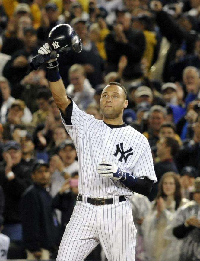 Derek Jeter tips his helmet to the fans