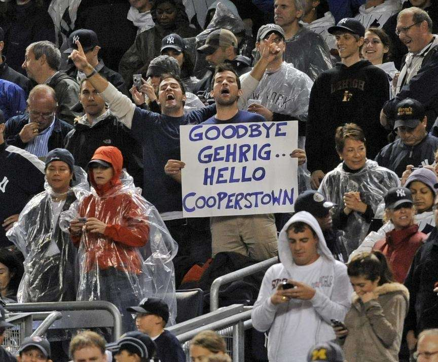 Fans celebrate after Derek Jeter set a new