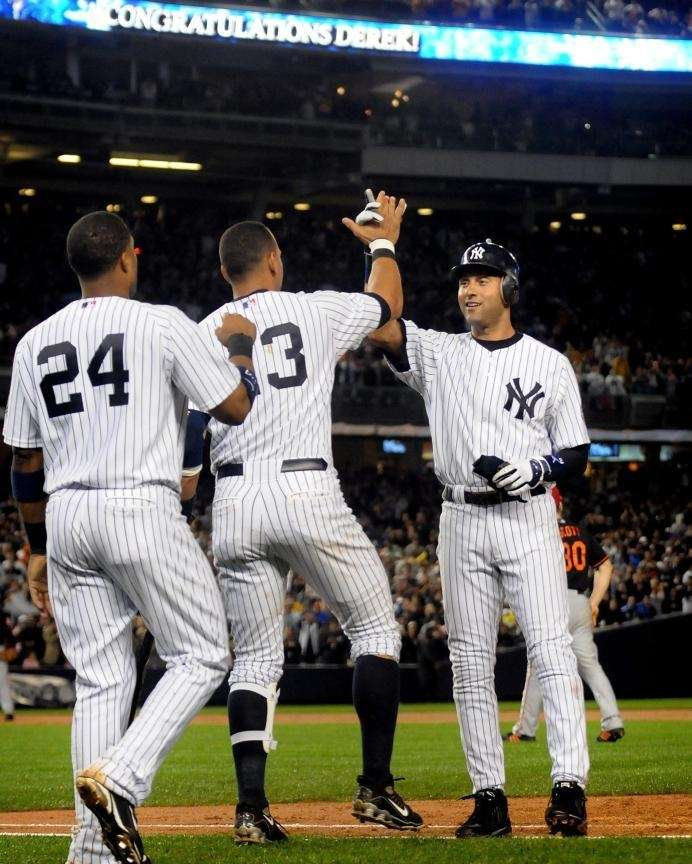Derek Jeter high-fives Alex Rodriguez after Jeter broke