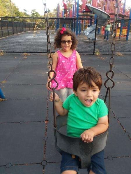 Big sister Olivia is pushing her little brother