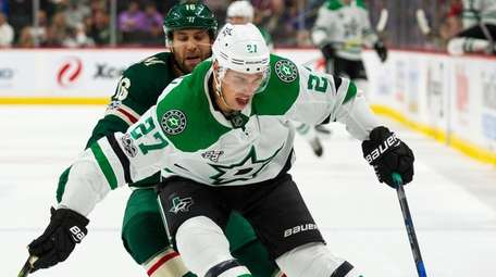 Dallas Stars right wing Adam Cracknell (27) protects