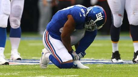 Sterling Shepard of theGiants reacts after being injured