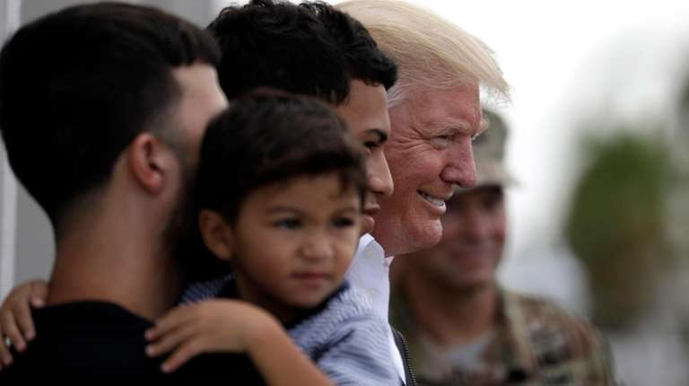President Donald Trump visits a disaster-relief distribution center