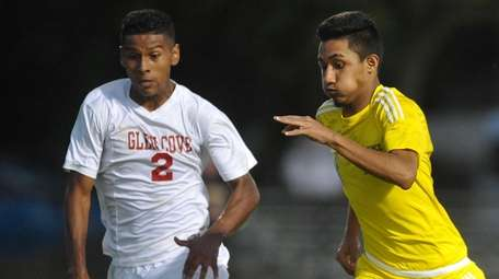 Mauricio Puerto-Quintanilla of Lawrence, right, tries to get