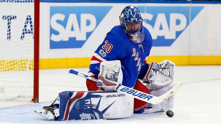 Henrik Lundqvist of the Rangers makes save in the