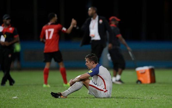 United States' Matt Besler, squats on the pitch