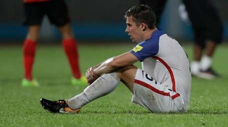 United States' Matt Besler, squats on the pitch