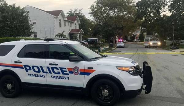 Nassau County police respond to an Elmont neighborhood